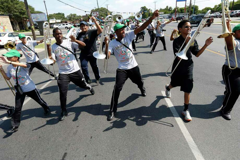 Members of Sam Houston High School's marching band perform during the parade. Photo: Kin Man Hui /San Antonio Express-News / ©2017 San Antonio Express-News