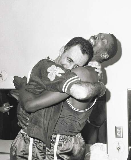 Bill Russell (right) hoists Bob Cousy in a victory hug after the Celtics' title-clinching win in L.A. Photo: Ed Widdis / Ed Widdis / Associated Press 1963