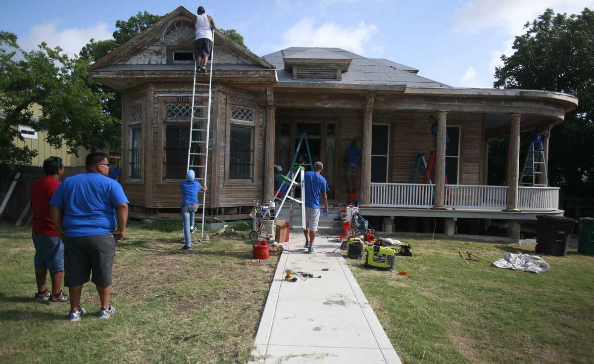 Haven for Hope volunteers help renovate the home of Miguel Calzada on West French Place. The home was slated for demolition by the city before Calzada's neighbors and friends rallied to save the structure. It has been designated a local historic landmark.