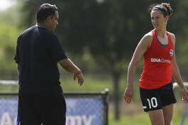 Houston Dash's Carli Lloyd talks to head coach Omar Morales during her first team practice this year at Houston Sports Park Thursday, June 15, 2017, in Houston. ( Yi-Chin Lee / Houston Chronicle )