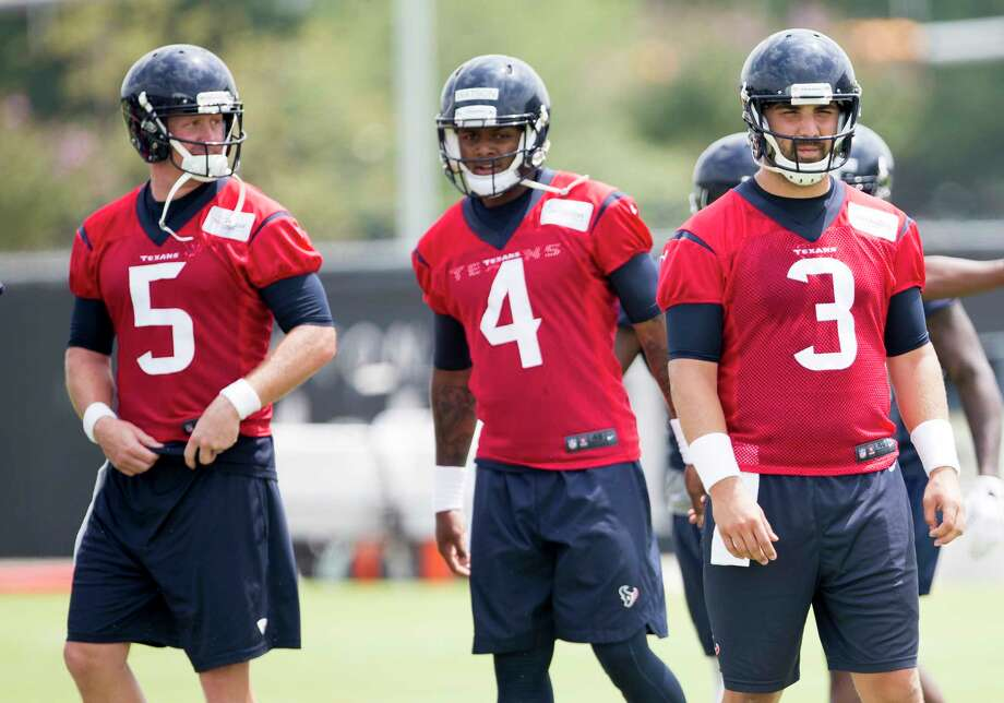 Houston Texans quarterback Brandon Weeden (5), Deshaun Watson (4) and Tom Savage (3) warm up during OTAs at The Methodist Training Center on Wednesday, May 31, 2017, in Houston. ( Brett Coomer / Houston Chronicle ) Photo: Brett Coomer, Staff / © 2017 Houston Chronicle