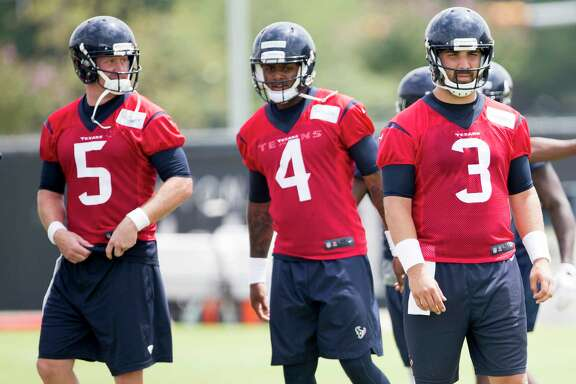 Houston Texans quarterback Brandon Weeden (5), Deshaun Watson (4) and Tom Savage (3) warm up during OTAs at The Methodist Training Center on Wednesday, May 31, 2017, in Houston. ( Brett Coomer / Houston Chronicle )
