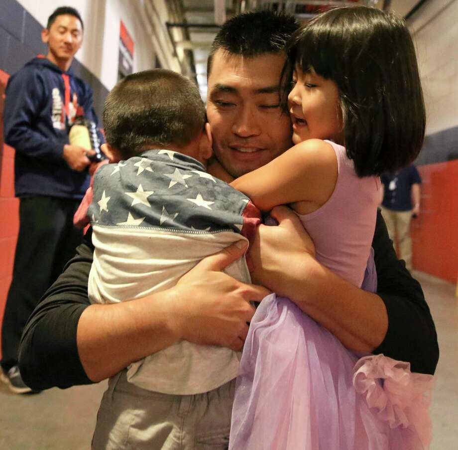 After recording his 2,000th hit as a professional in last Sunday's home game against the Angels, Astros outfielder Nori Aoki was pleased to celebrate the milestone with his son and daughter. Photo: Yi-Chin Lee, Staff / © 2017  Houston Chronicle
