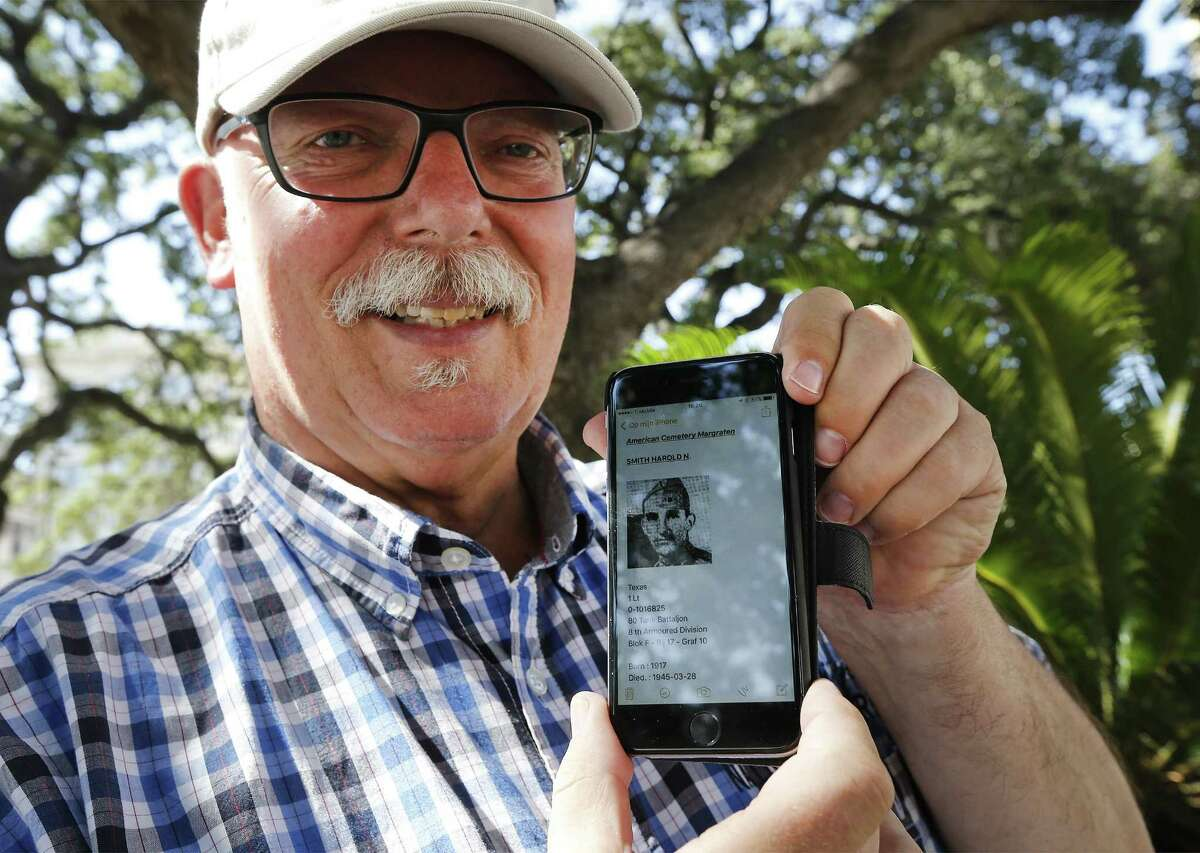 Don Schmitz of Margraten, Netherlands shows a digital image of Harold Norman Smith, a World War II American soldier who perished during the war, who's headstone that Schmitz has watched over for the past 20 years. Schmitz and his family paid a visit to San Antonio on Friday, June 16, 2017. The soldier, Norman Harold Smith, was from San Antonio and, with the help of the Internet and some friendly Texans, Schmitz connected with family members in San Antonio this week. He lives in the Dutch village where the World War II Netherlands American Cemetery and Memorial entomb 8,301 soldiers who perished during WWII. When Schmitz signed up to care for a headstone that only had the name of Norman Harold Smith, the Dutchman began his journey to find relatives with the deceased soldier from San Antonio. (Kin Man Hui/San Antonio Express-News)
