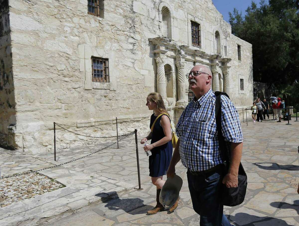 Don Schmitz (right) of Margraten, Netherlands and his family visit the Alamo during a recent trip to San Antonio on Friday, June 16, 2017. For the past 20 years, Schmitz has been the caretaker of a gravesite of a World War II American soldier killed in the Netherlands. The soldier, Norman Harold Smith, was from San Antonio and, with the help of the Internet and some friendly Texans, Schmitz connected with family members in San Antonio this week. Schmitz lives in the Dutch village where the World War II Netherlands American Cemetery and Memorial entombs 8,301 soldiers who perished during WWII. When Schmitz signed up to care for a headstone that only had the name of Norman Harold Smith, the Dutchman began his journey to find relatives with the deceased soldier from San Antonio. (Kin Man Hui/San Antonio Express-News)