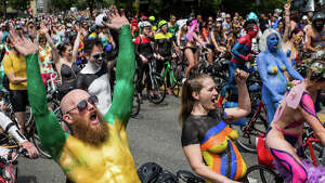 Naked cyclists in creative paint wait to ride before the Fremont Solstice Parade on Saturday, June 17, 2017.