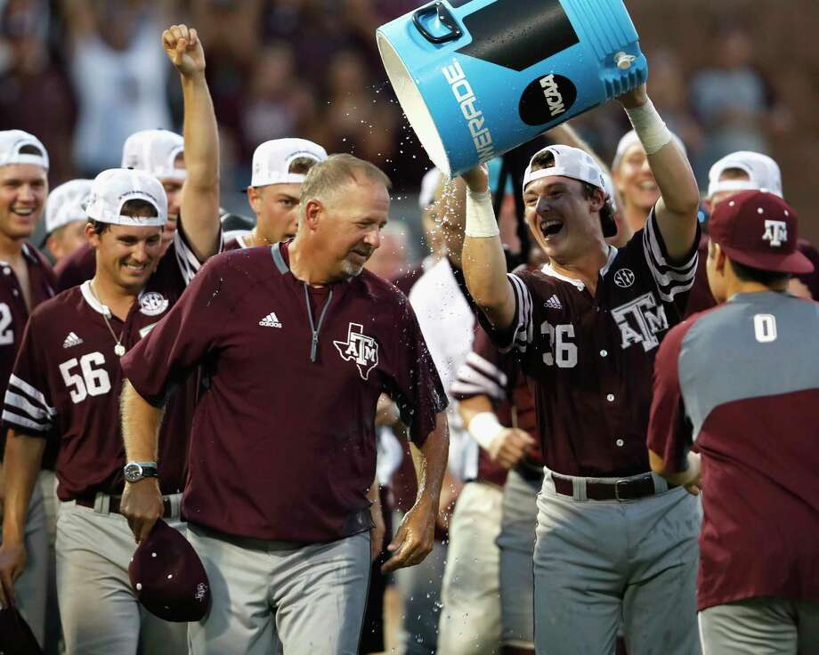 A&M coach Rob Childress, center, was deserving of a Gatorade bath upon sweeping his way to the College World Series after his Aggies defeated Davidson in the NCAA super regionals last week. After various slides during the year, A&M enters the eight-team field on a roll. Photo: Tim Warner, Freelance / Houston Chronicle
