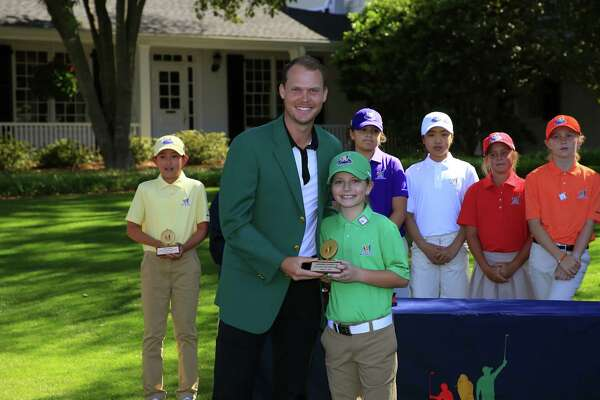 Masters champion Danny Willett of England presents the Girls 10-11 age group Best Chip award to Kennedy Swedick of Voorheesville during the Drive, Chip and Putt National Finals at Augusta National Golf Club, Sunday, April 2, 2017.