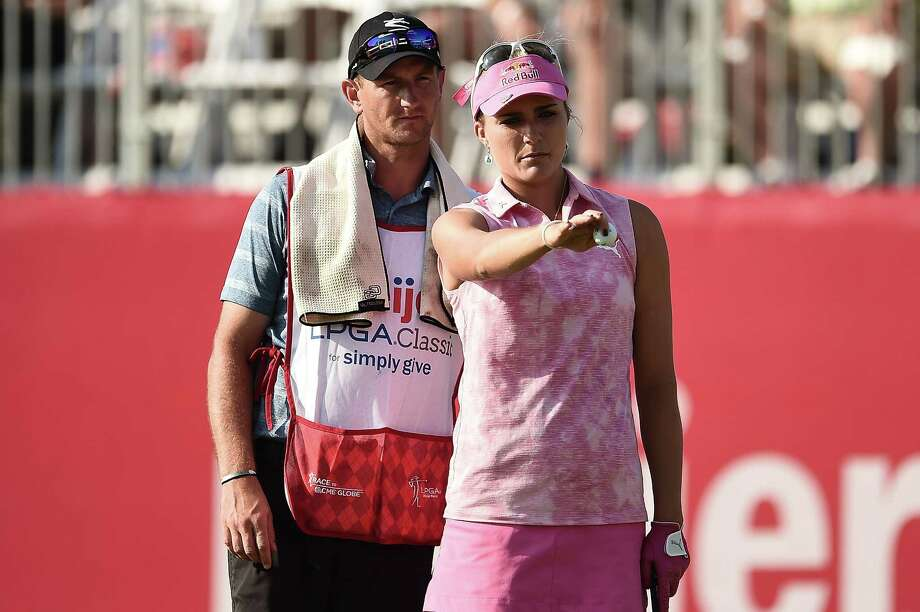 Lexi Thompson, right, shot a 64 Saturday to take a one-shot lead at the Meijer LPGA Classic. Photo: Stacy Revere, Stringer / 2017 Getty Images