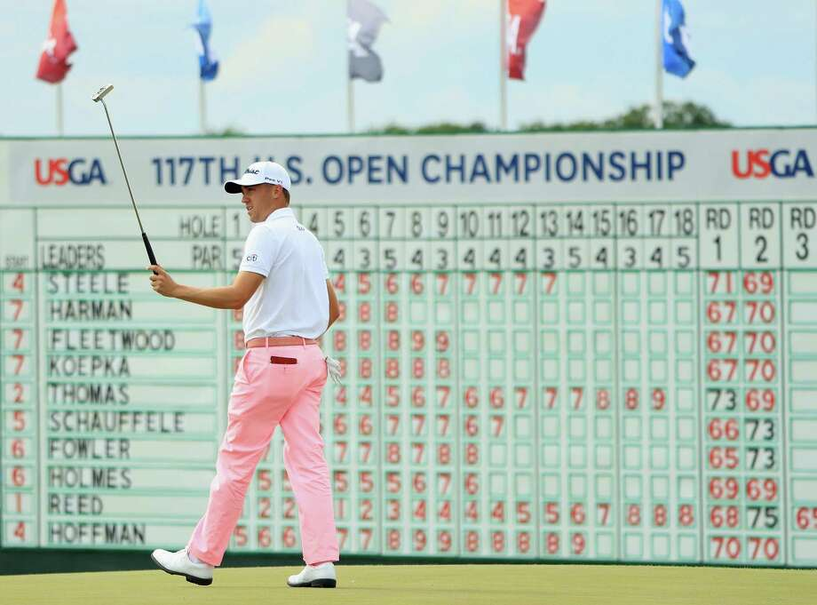 Justin Thomas reacts after making an eagle on the 18th hole during the third round of the U.S. Open at Erin Hills on Saturday. Thomas shot a 9-under 63 to set one U.S. Open record and tie another. Photo: Andrew Redington, Staff / 2017 Getty Images
