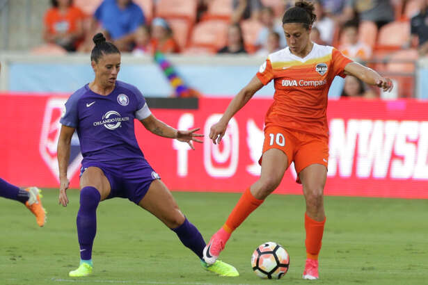 Houston Dash forward Carli Lloyd (10) is defensed by Orlando Pride defender Ali Krieger (11) during the first half of the game at BBVA Compass Stadium Saturday, June 17, 2017, in Houston. ( Yi-Chin Lee / Houston Chronicle )