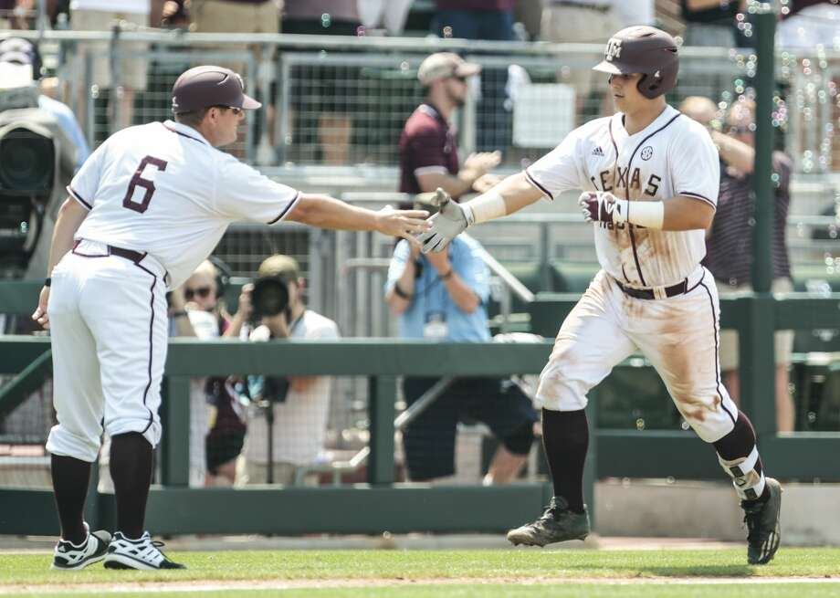 Texas A&M catcher Hunter Coleman (10) rounds third past third base coach Will Bolt (6) after hitting a two-run home run off Davidson pitcher Durin O'Linger (34) during the NCAA baseball Super Regional at Olsen Field at Blue Bell Park on Friday, June 9, 2017, in College Station. Texas A&M beat Davidson 7-6 in 15 innings. ( Brett Coomer / Houston Chronicle ) Photo: Brett Coomer/Houston Chronicle