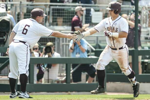 Texas A&M catcher Hunter Coleman (10) rounds third past third base coach Will Bolt (6) after hitting a two-run home run off Davidson pitcher Durin O'Linger (34) during the NCAA baseball Super Regional at Olsen Field at Blue Bell Park on Friday, June 9, 2017, in College Station. Texas A&M beat Davidson 7-6 in 15 innings. ( Brett Coomer / Houston Chronicle )
