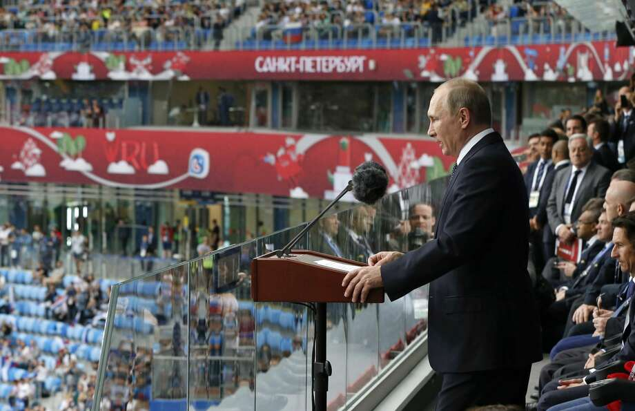 Russian President Vladimir Putin, right, speaks before the Confederations Cup, Group A soccer match between Russia and New Zealand, at the St. Petersburg Stadium, in St. Petersburg, Russia, Saturday, June 17, 2017. The Confederations Cup has kicked off with host nation Russia opening the World Cup rehearsal tournament against New Zealand. (Dmitry Astakhov/Sputnik, Government Pool Photo via AP) Photo: Dmitry Astakhov/Associated Press