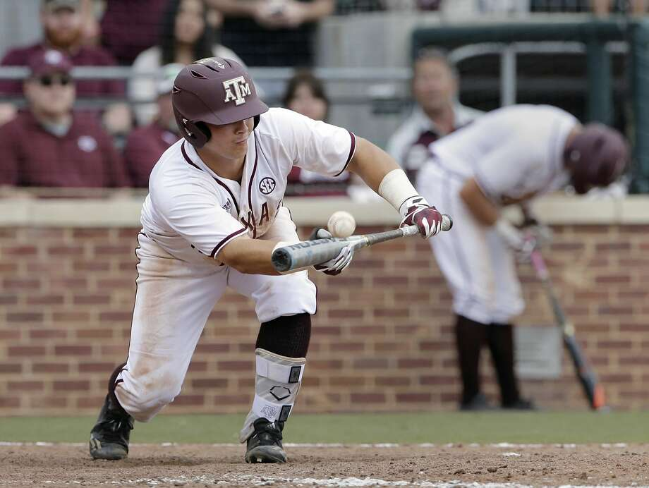 Texas A M's Hunter Coleman (10) bunts in the 15th inning against Davidson in an NCAA college baseball tournament super regional game Friday, June 9, 2017, in College Station, Texas. (AP Photo/Michael Wyke) Photo: Michael Wyke/Associated Press