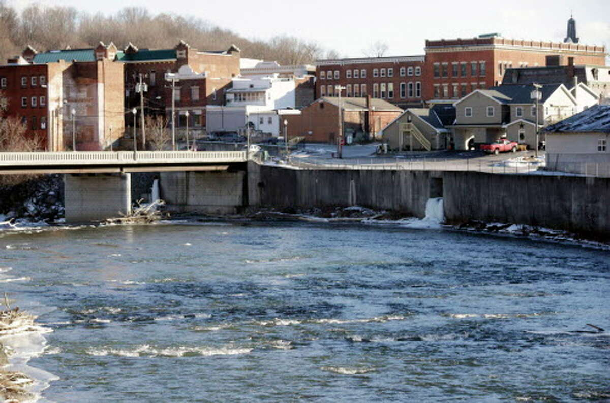 FILE - In this Jan. 21, 2016 file photo, the Hoosic River runs through the village of Hoosick Falls, N.Y. No higher incidences of certain types of cancer linked to the toxic chemical PFOA were found in the upstate New York village whose water supplies were contaminated by the chemical, state health officials said in a report released Wednesday, June 7, 2017. (AP Photo/Mike Groll, File) ORG XMIT: NYR102
