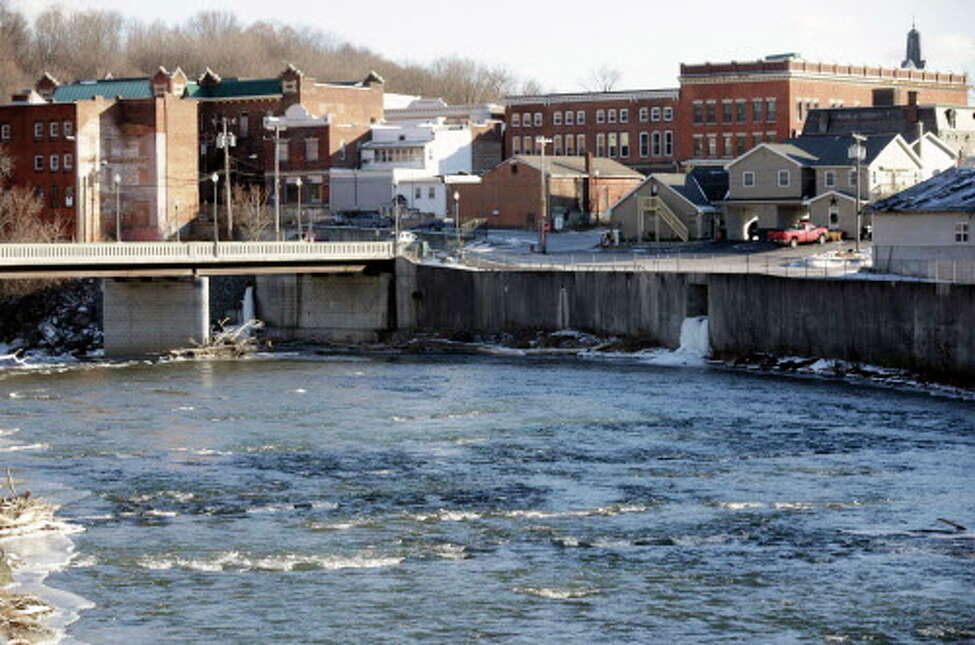 FILE - In this Jan. 21, 2016 file photo, the Hoosic River runs through the village of Hoosick Falls, N.Y. (AP Photo/Mike Groll, File)