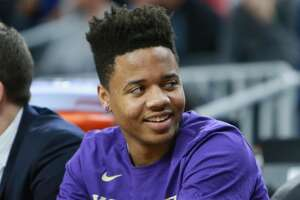 LAS VEGAS, NV - MARCH 08:  Markelle Fultz #20 of the Washington Huskies sits on the bench with an injured ankle against the USC Trojans during a first-round game of the Pac-12 Basketball Tournament at T-Mobile Arena on March 8, 2017 in Las Vegas, Nevada. USC wins 78-73  (Photo by Leon Bennett/Getty Images)