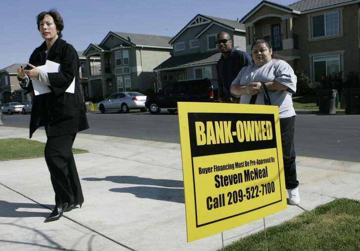 A real estate agent walks into a bank owned home she is showing to clients in Stockton, Calif. A report published Friday by Harvard University's Joint Center For Housing Studies found that the number of Americans spending 50 percent of their income on rent is near historic highs.