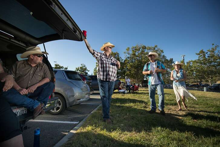 "John Garrison, Mark Watson, Kenneth Jensen and wife, Jessica Jensen meet up before watching Brad Paisley perform at the Shoreline Amphitheater on Saturday, June 17, 2017 in Mountain View, CA.  Watson, who grew up on a cattle ranch in Colorado, raising cattle, says he enjoys Country Western music because ""this is what I knew."""