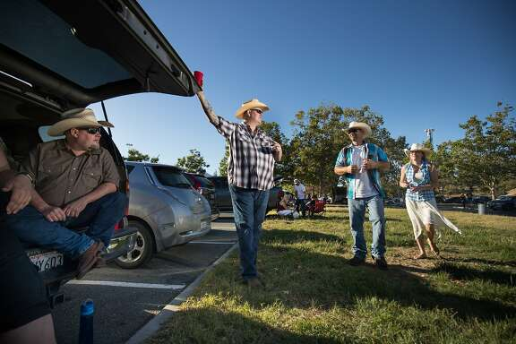 """John Garrison, Mark Watson, Kenneth Jensen and wife, Jessica Jensen meet up before watching Brad Paisley perform at the Shoreline Amphitheater on Saturday, June 17, 2017 in Mountain View, CA.  Watson, who grew up on a cattle ranch in Colorado, raising cattle, says he enjoys Country Western music because """"this is what I knew."""""""