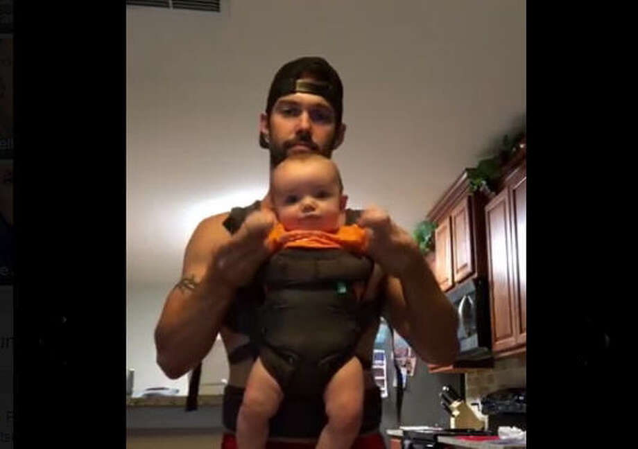 Robert Douglas and 6-month-old Dantyn spend Saturday night dancing. 