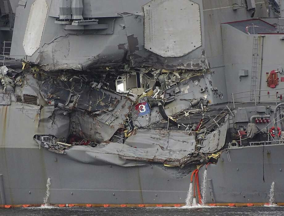 Damage to the destroyer Fitzgerald is seen at the Yokosuka naval base, home of the Navy's Seventh Fleet. Photo: Eugene Hoshiko, Associated Press