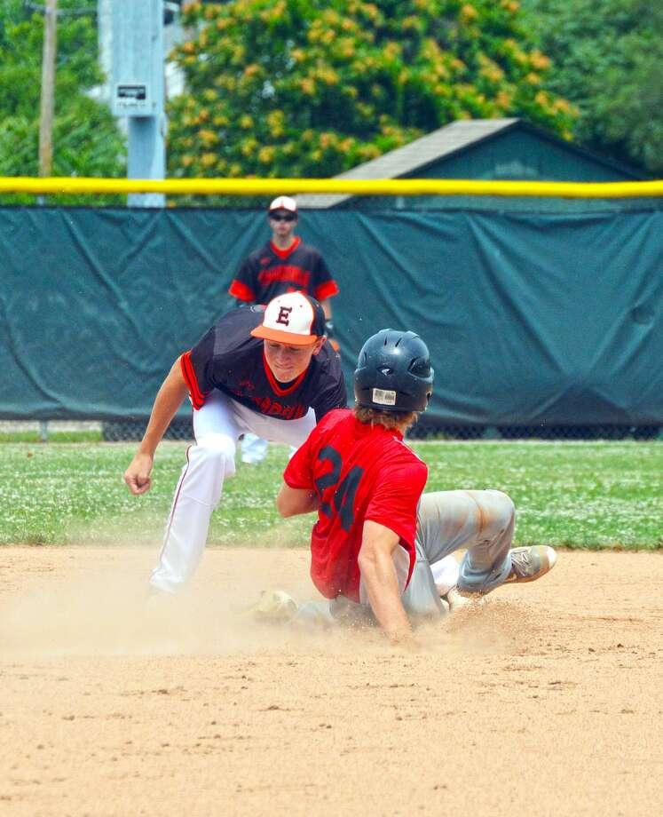 Edwardsville second baseman Zac Crutchfield tags out a would-be base stealer.