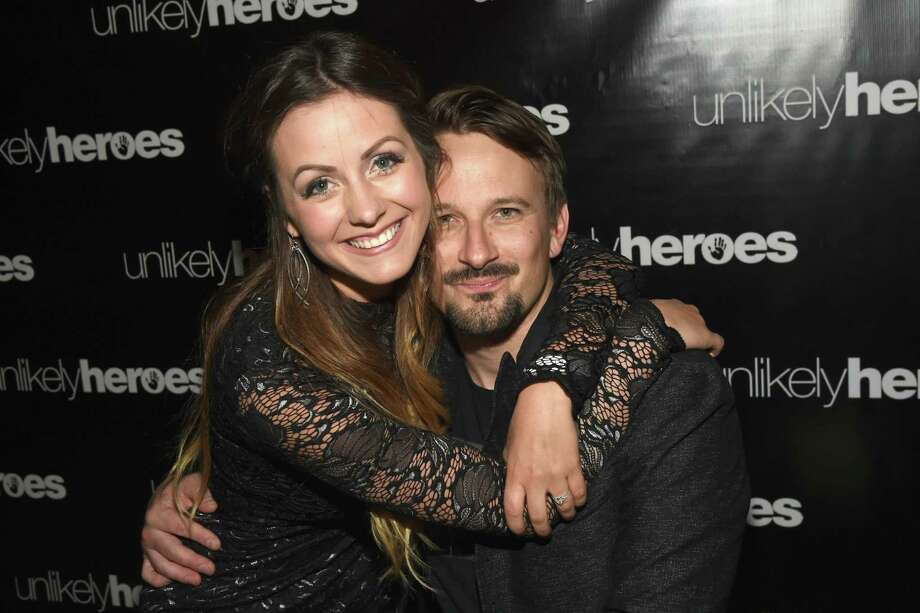 NASHVILLE, TN - MAY 02:  (L-R) Bachelor couple Carly Waddell and Evan Bass take photos for Unlikely Heroes hosts, Night of Freedom, A Tribute to the Legend George Michael at City Winery Nashville on May 2, 2017 in Nashville, Tennessee.  (Photo by Rick Diamond/Getty Images for Unlikely Heroes) | Photo Credits: Rick Diamond, Getty Images for Unlikely Heroes / 2017 Getty Images