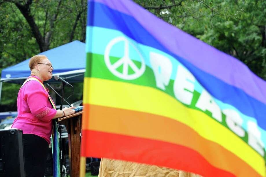Rev. Jacqueline Gilchrist, senior minister at the North Stamford Community Church, speaks during the celebration of pride and solidarity with the LGBT community in Latham Park in downtown Stamford, Conn. on Sunday, June 18, 2017. The Interfaith Council of Southwestern Connecticut and the Triangle Community Center, in Norwalk, joined together to host the service with the First Congretional Church of Stamford, the Unitarian Universalist Congregation, the North Stamford Community Church and Temple Beth El. Photo: Michael Cummo, Hearst Connecticut Media / Stamford Advocate