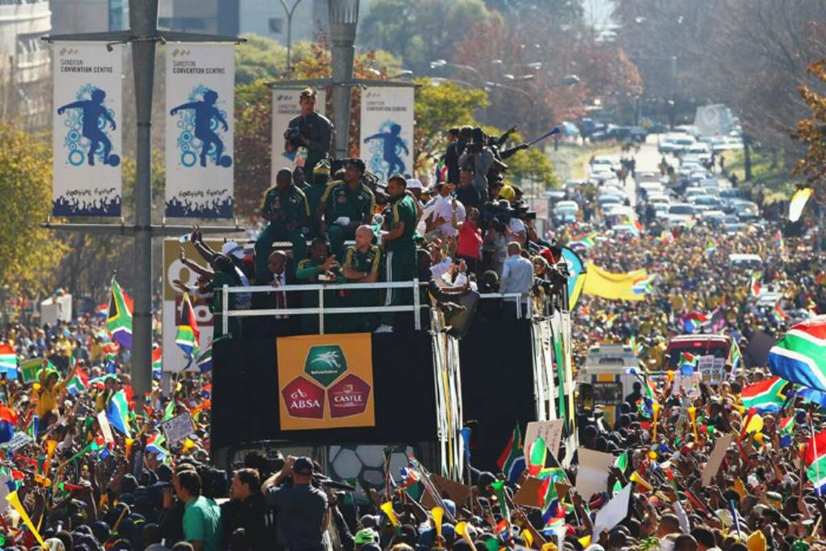 SANDTON, SOUTH AFRICA - JUNE 09: The South Africa team parade through the district of Sandton as thousands of local supporters cheer on June 9, 2010 in Sandton, South Africa. (Photo by Michael Steele/Getty Images)