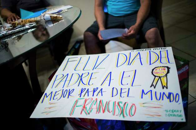 A sign congratulating Juan Rodriguez on Father's Day created by his daughters rests on top of gift bags as he silently reads a letter written by his daughter Rebecca Rodriguez, Sunday, June 18, 2017, in Houston. Photo: Marie D. De Jesus, Houston Chronicle / © 2017 Houston Chronicle