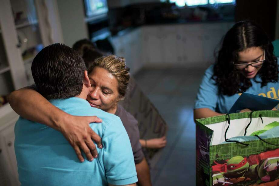 Celia Rodriguez embraces her husband, Juan, congratulating him on Father's Day. The family is hoping that lawyers will be able to help them stay together. Photo: Marie D. De Jesus, Houston Chronicle / © 2017 Houston Chronicle