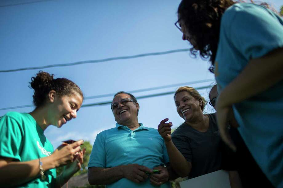 Juan Rodriguez and his wife Celia Rodriguez joke with theirs daughters Karen Rodriguez, left, 18, Rebecca Rodriguez, right, 15, and Kimberly Rodriguez during Father's Day, Sunday, June 18, 2017, in Houston. Photo: Marie D. De Jesus, Houston Chronicle / © 2017 Houston Chronicle