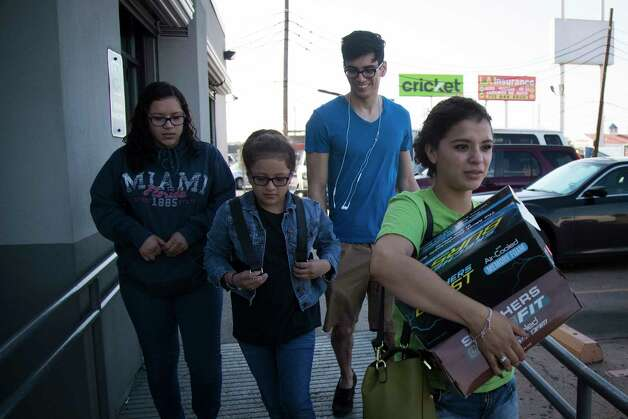 (left to right) Rebecca Rodriguez, 15, Kimberly Rodriguez, center, 10, Norbert Donias, 28, and Karen Rodriguez, 18, exit a store with Father's Day gifts for the sister's father, Juan Rodriguez, Friday, June 16, 2017, in Houston. Photo: Marie D. De Jesus, Houston Chronicle / © 2017 Houston Chronicle