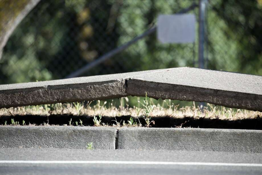 It was so hot in Santa Rosa Saturday, the sidewalk appeared to buckle on Chanate Road. Santa Rosa resident and freelance photographer Andrew Leonard captured these photos. Photo: Andrew Leonard/Santa Rosa
