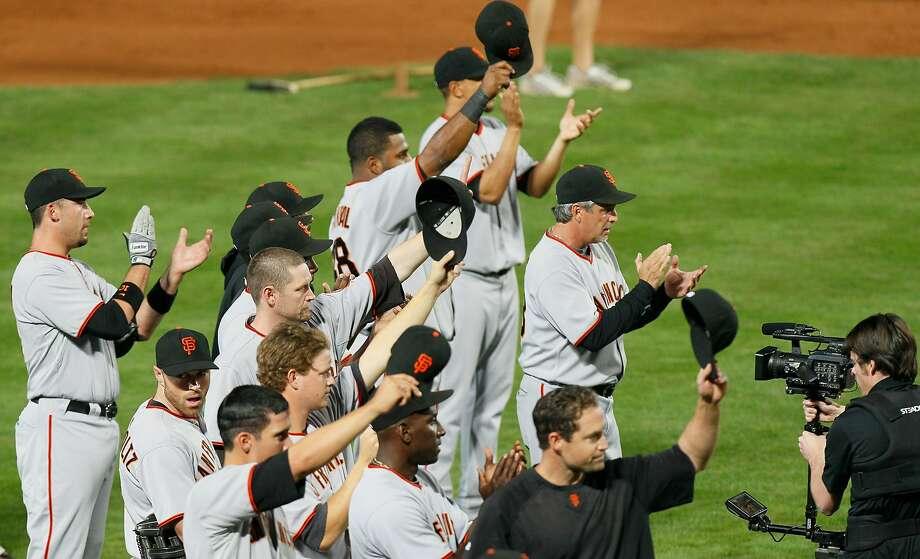 Posey, Giants recall special Atlanta moment, await new ballpark