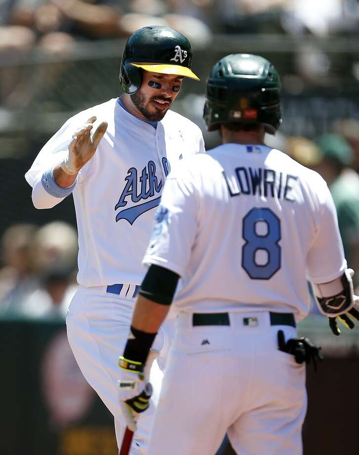 Oakland Athletics' Matt Joyce, left, is congratulated by teammate Jed Lowrie, right, after hitting a solo home run against the New York Yankees during the first inning of a baseball game on Saturday, June 17, 2017 in Oakland, Calif. (AP Photo/Tony Avelar) Photo: Tony Avelar, Associated Press