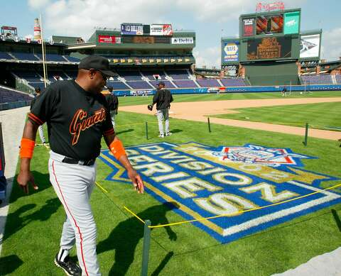 fc7a5d04767339 San Francisco Giants manager Dusty Baker looks at the Division Series logo  on the field at