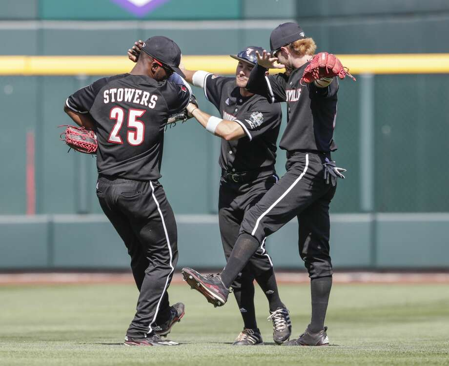 Louisville outfielders Josh Stowers (25), Logan Taylor, center, and Colin Lyman, right, celebrate at the end of an NCAA College World Series baseball game against Texas A&M in Omaha, Neb., Sunday, June 18, 2017. Louisville won 8-4. (AP Photo/Nati Harnik) Photo: Nati Harnik/Associated Press