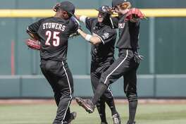 Louisville outfielders Josh Stowers (25), Logan Taylor, center, and Colin Lyman, right, celebrate at the end of an NCAA College World Series baseball game against Texas A&M in Omaha, Neb., Sunday, June 18, 2017. Louisville won 8-4. (AP Photo/Nati Harnik)