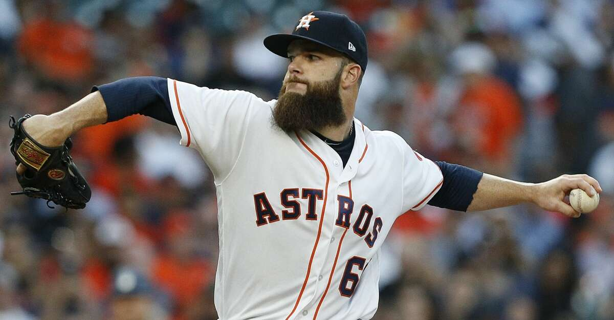 HOUSTON, TX - APRIL 03: Dallas Keuchel #60 of the Houston Astros pitches in the first inning against the Seattle Mariners on Opening Day at Minute Maid Park on April 3, 2017 in Houston, Texas. (Photo by Bob Levey/Getty Images)
