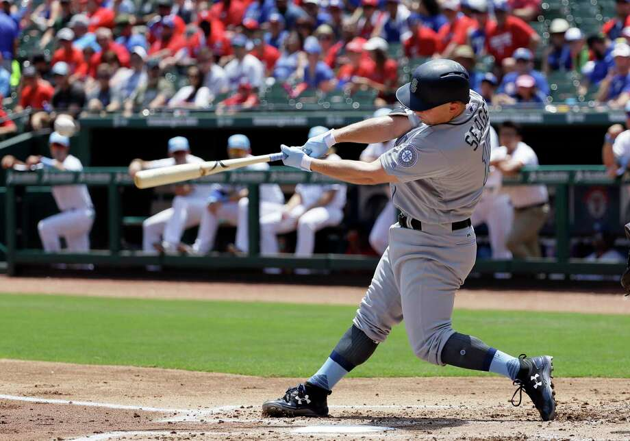 Seattle Mariners' Kyle Seager follows through on a run-scoring double off a pitch from Texas Rangers' Yu Darvish during the first inning of a baseball game, Sunday, June 18, 2017, in Arlington, Texas. (AP Photo/Tony Gutierrez) Photo: Tony Gutierrez, STF / Copyright 2017 The Associated Press. All rights reserved.