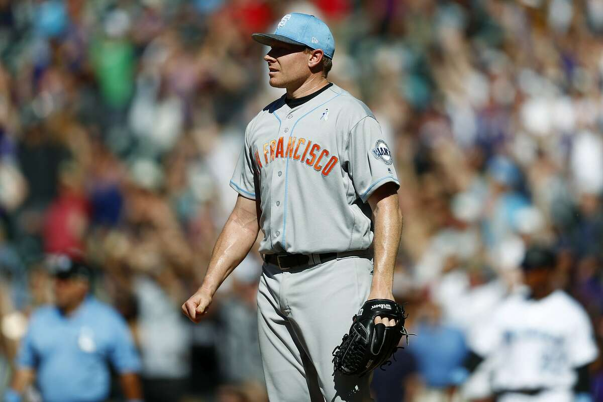 San Francisco Giants relief pitcher Mark Melancon follows the flight of a three-run, walkout home run that he gave up to Colorado Rockies' Nolan Arenado in the ninth inning of a baseball game, Sunday, June 18, 2017, in Denver. The Rockies won 7-5.