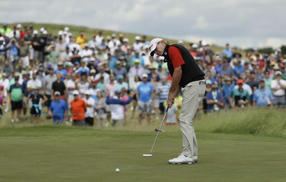 Wisconsin native Steve Stricker putts on the ninth hole during the fourth round of the U.S. Open before a loyal group of fans at Erin Hills. Photo: David J. Phillip, Associated Press