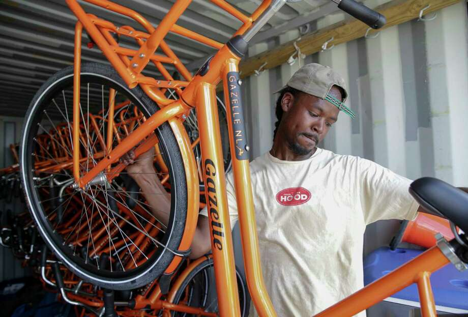 Alan Moore, co-founder of 3rd Ward Tours, moves bicycles from their storage container Sunday. The bicycle tour company has 20 new bicycles for group tours in the community. Photo: Yi-Chin Lee, Staff / © 2017  Houston Chronicle