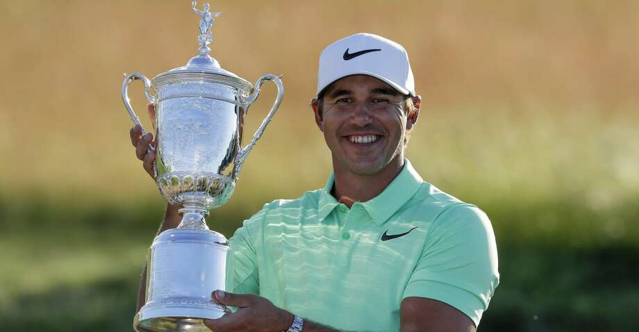 Brooks Koepka poses with the winning trophy after the U.S. Open golf tournament Sunday, June 18, 2017, at Erin Hills in Erin, Wis. (AP Photo/Chris Carlson) Photo: Chris Carlson/Associated Press
