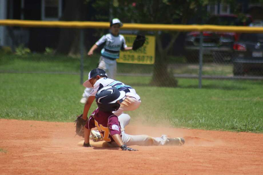 Deer Park's Nathan Zbranek becomes an out at second base on a close play during Sunday afternoon's game with Pasadena.  The two regional bound teams meet again Monday night at 6:30. Photo: Robert Avery