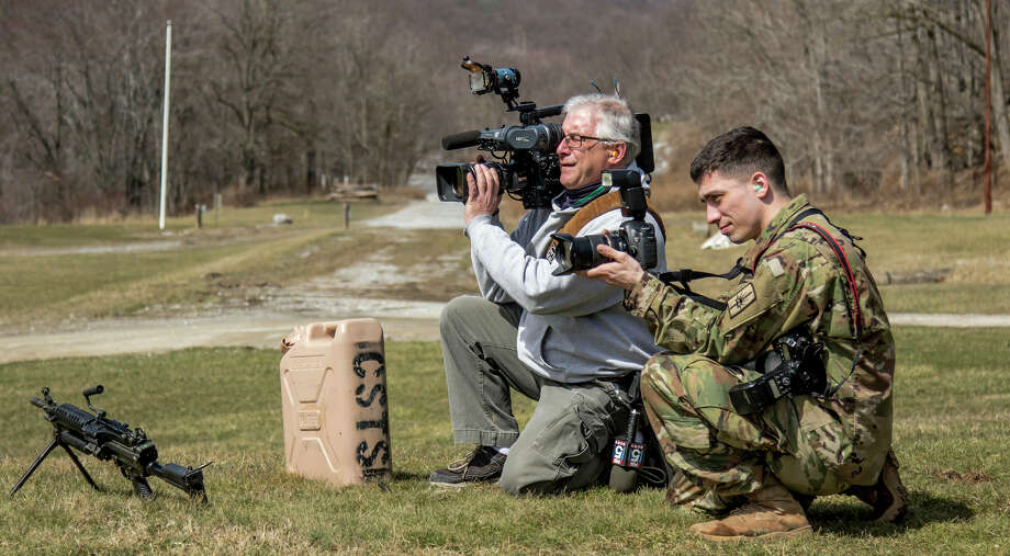 New York Army National Guard Army National Guard Sgt. Harley Jelis, right, a 138th Public Affairs Detachment photojournalist, takes photos of training at at Fort Polk, La.