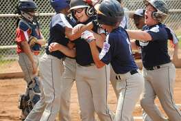 Klaus Schroeder is mobbed by his teammates at home plate after belting a three run home run in the 7th inning to win the first of two games to win the Norwalk Little League championship at Broad River Field in Norwalk, Conn. on Sunday, June 18, 2017. Norwalk Linen won the game 9-3.
